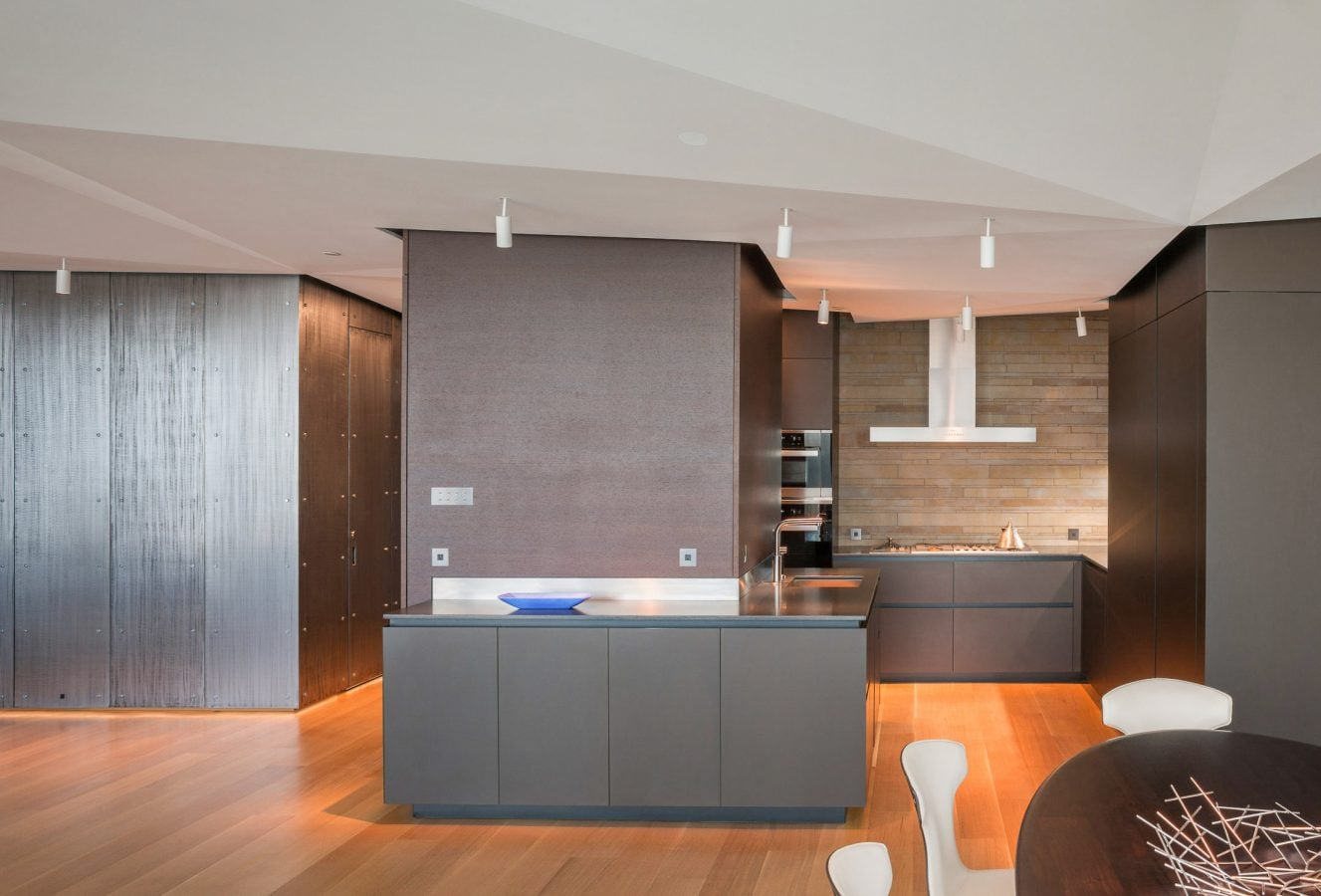 Kitchen of apartment with slate wall panels
