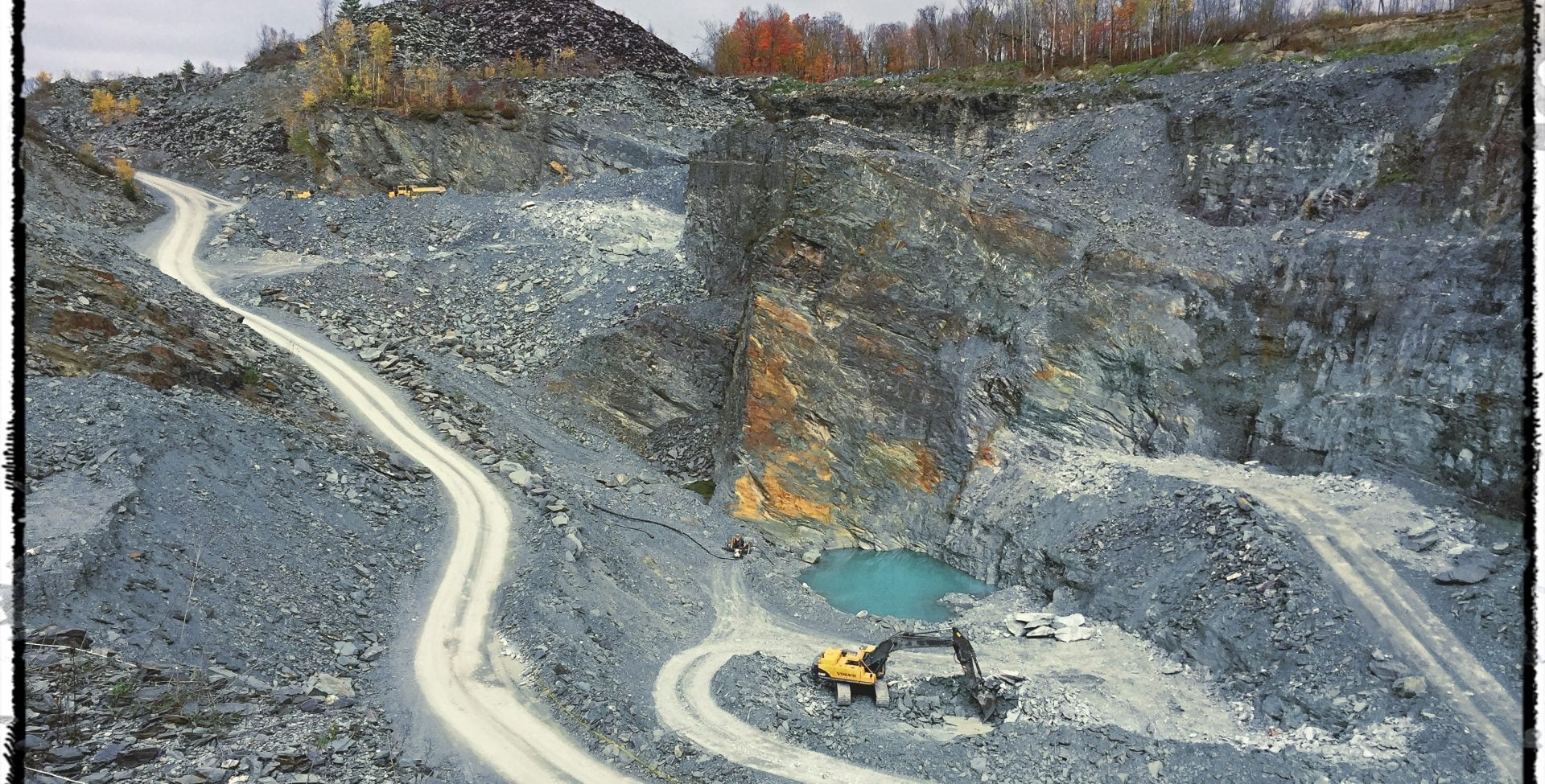 excavators cleaning up the quarry